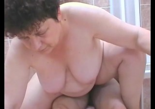 older woman sucks and copulates a youthful boy in