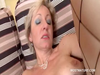 older golden-haired floozy masturbates with dildo