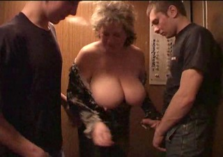 aged big beautiful woman with youngers boys in